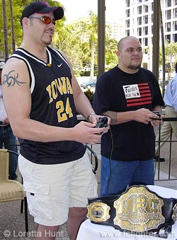 Tim Sylvia (left) playing UFC video game against Cabbage Correira