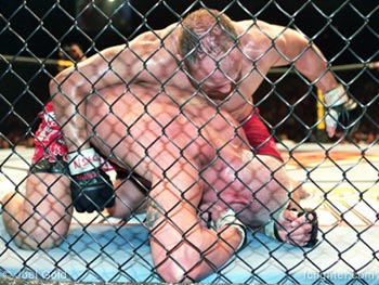 Randy Couture pounding on Tito Ortiz at UFC 44