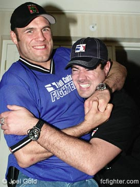 Randy Couture putting the squeeze on Carson Daly