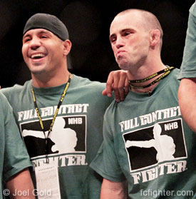 Jens Pulver (right) at UFC 49 standing next to Tony Fryklund after training partner Justin Eilers KO'd Mike Kyle