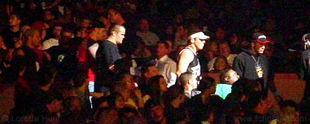 Miletich team walks Jason Black through the crowd