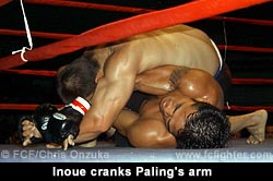 Kazuhiro Inoue cranking Bozo Paling's arm