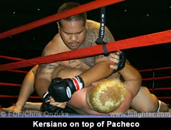 Moses Kersiano drives a forearm into Dustin Pacheco's neck